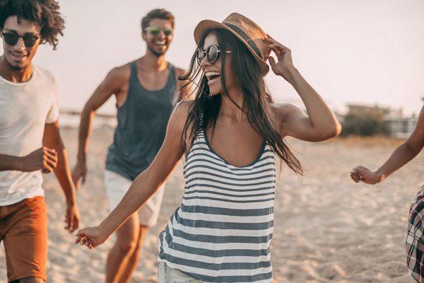 Friends running on a beach