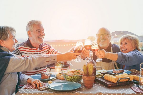 Older couples cheers at dinner
