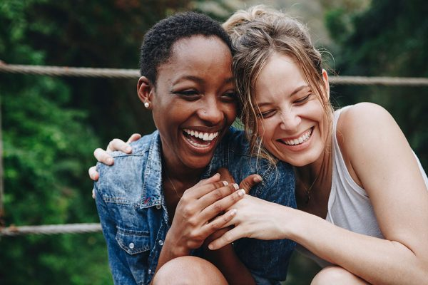 Two friends smiling and laughing together