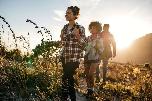 Friends hiking in a line
