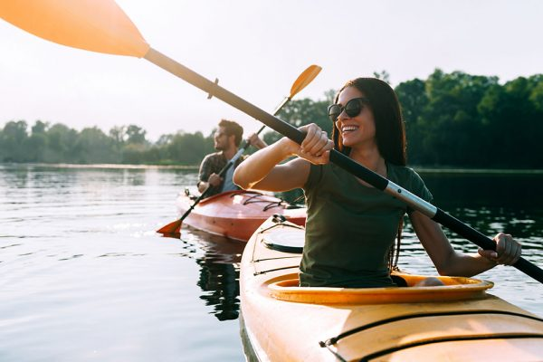 Couple kayaking on still waters