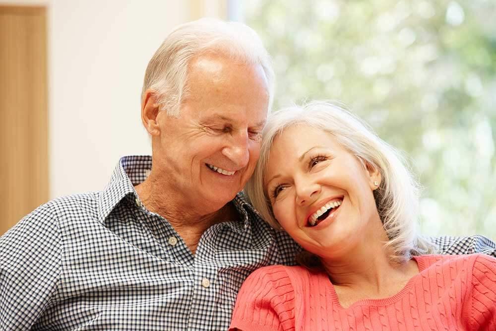 Older couple sitting together smiling